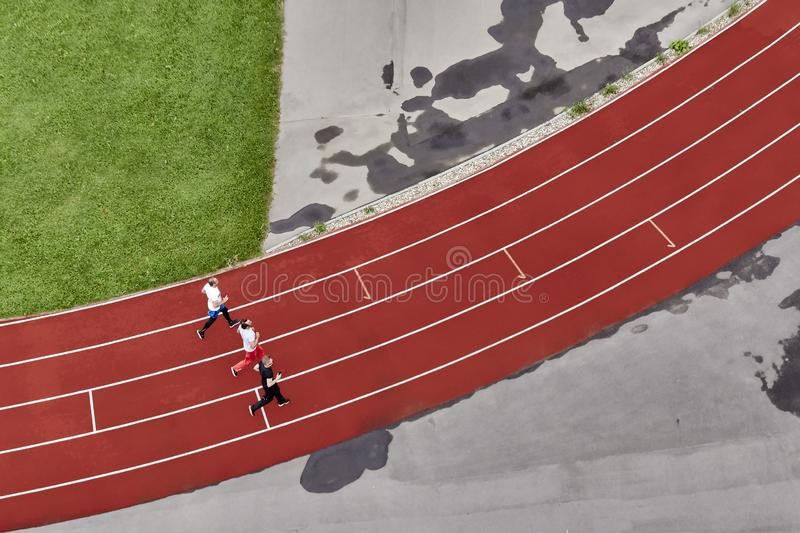 Three runners on a treadmill, top view stock photo