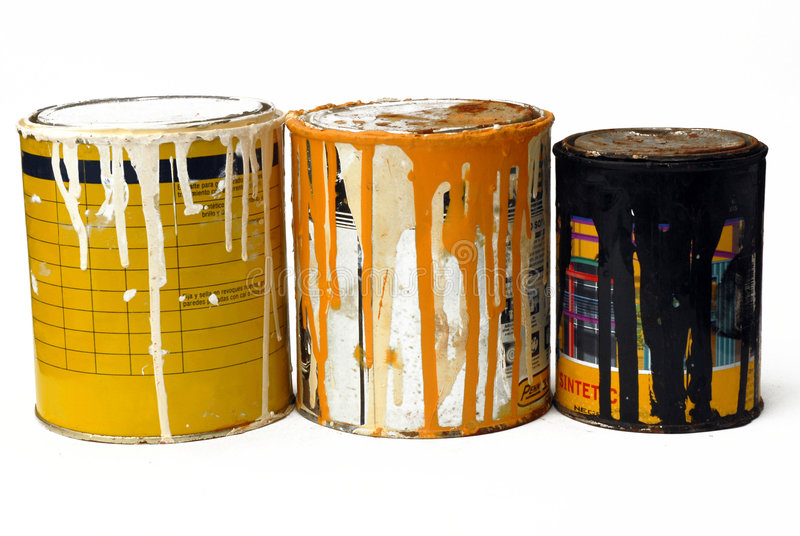 Three rusty paint cans stock image