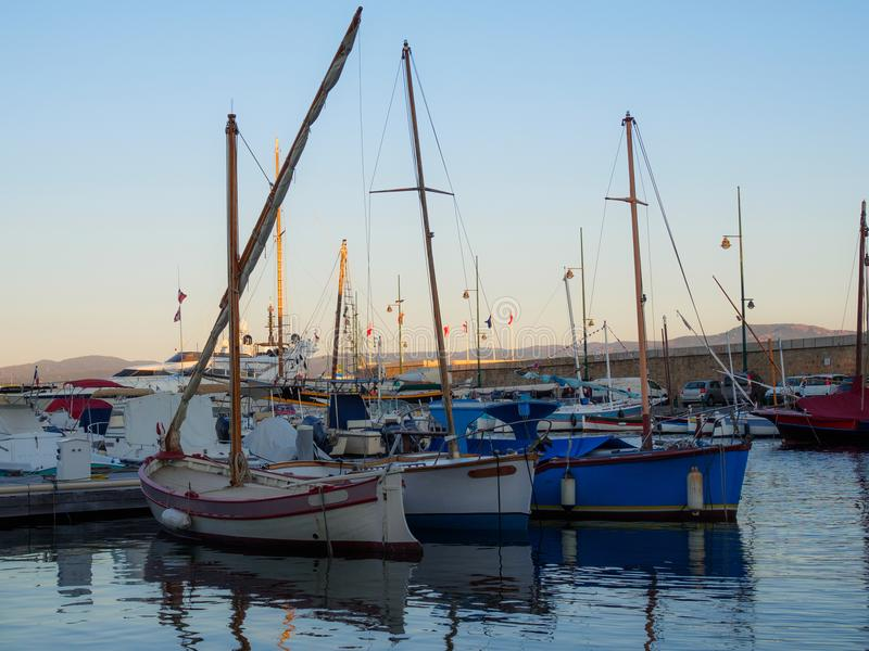 Three sailboats lined up in the harbor of Saint-Tropez. stock image