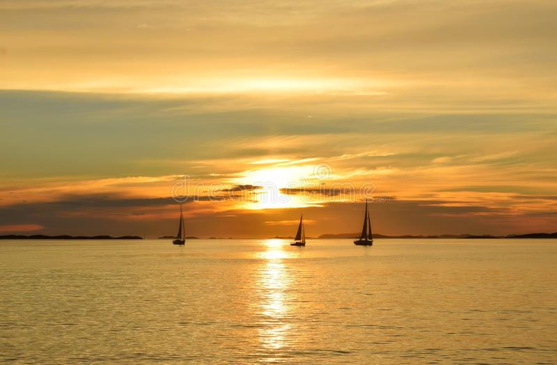 Three sailboats On the Sunset royalty free stock photography