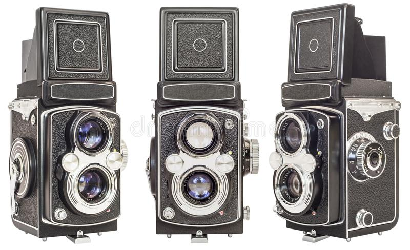 Three Same Make Old Twin Lens Reflex Cameras Isolated On White Background stock images