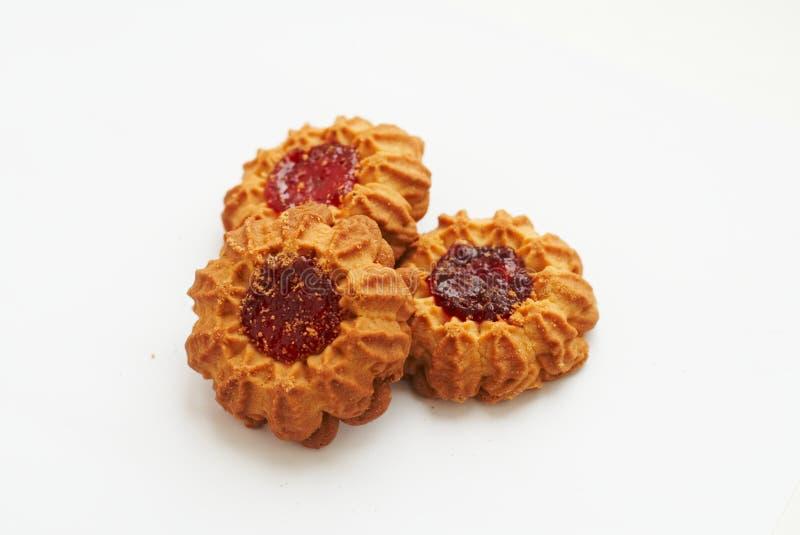 Three sand cookies with jam stock photos