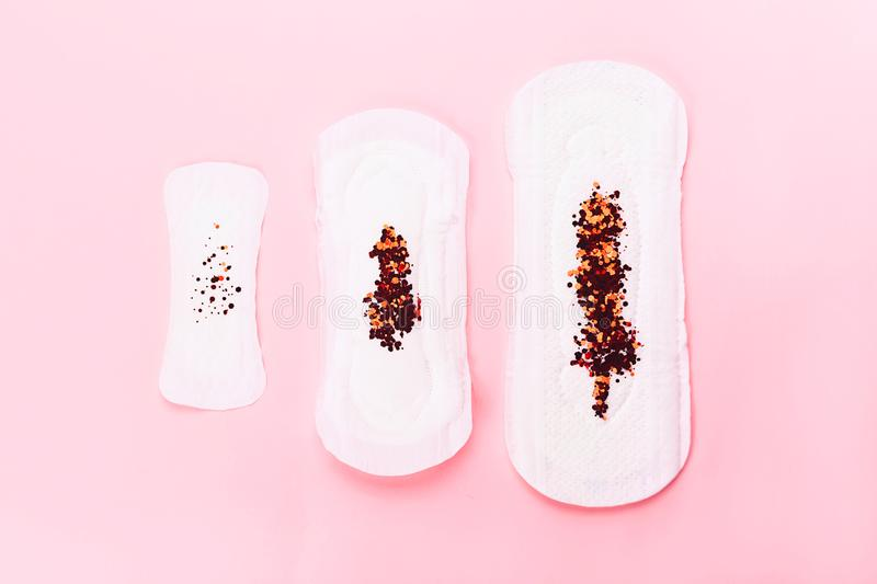 Three sanitary pads on pink background stock images