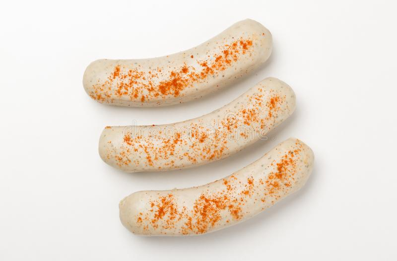 Three sausages with paprika stock images