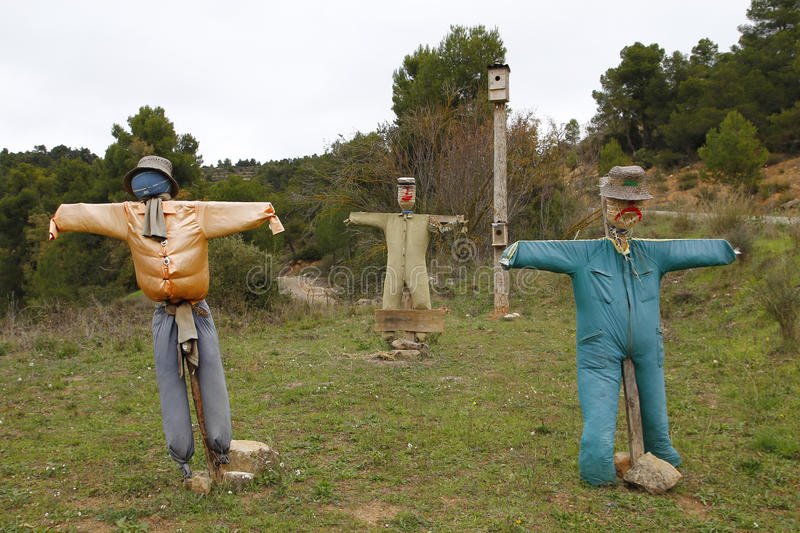 Three scarecrows with open arms royalty free stock photo