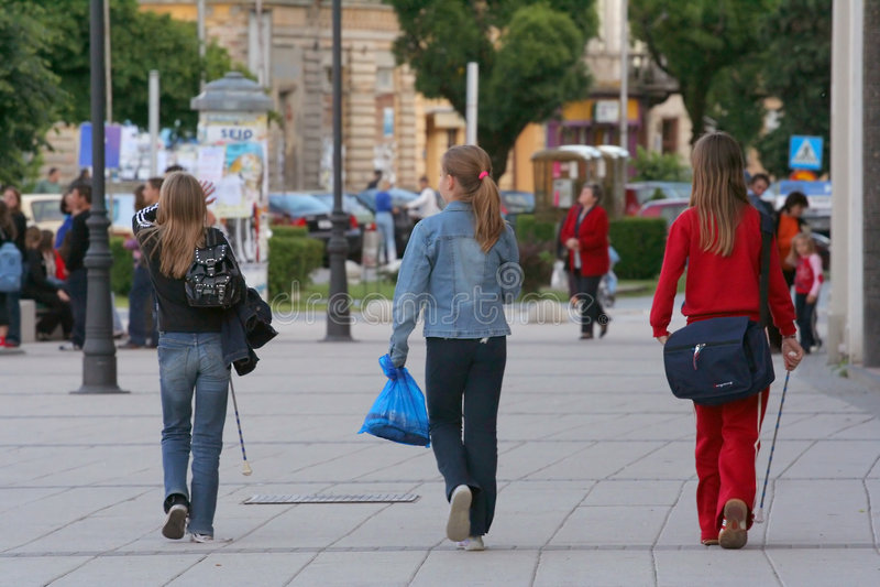 Three schoolgirls stock images