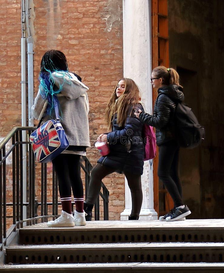 Three schoolgirls on the narrow street of Venice stock images