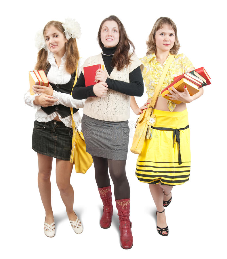 Three schoolgirls or students with books