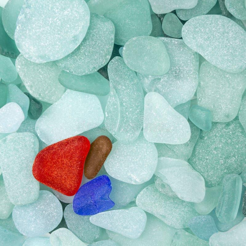 Three sea glass pieces stock photography