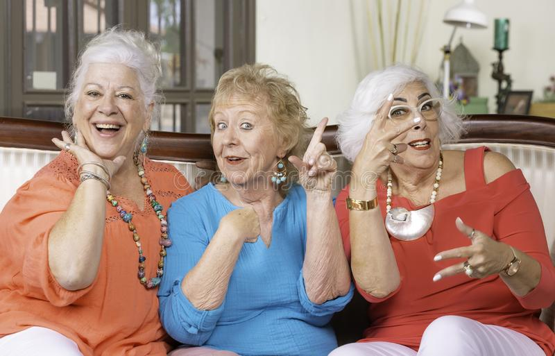 Three Senior Women Posing on a couch stock photography