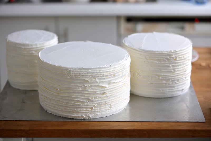 Three separate layers of one naked torte cake before putting tog. Ether stock photography
