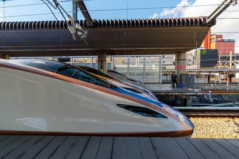 Three Series E7 Shinkansens. Tokyo, Japan - March 04, 2015: Three Series E7 Shinkansens sit side by side at Tokyo station stock photography