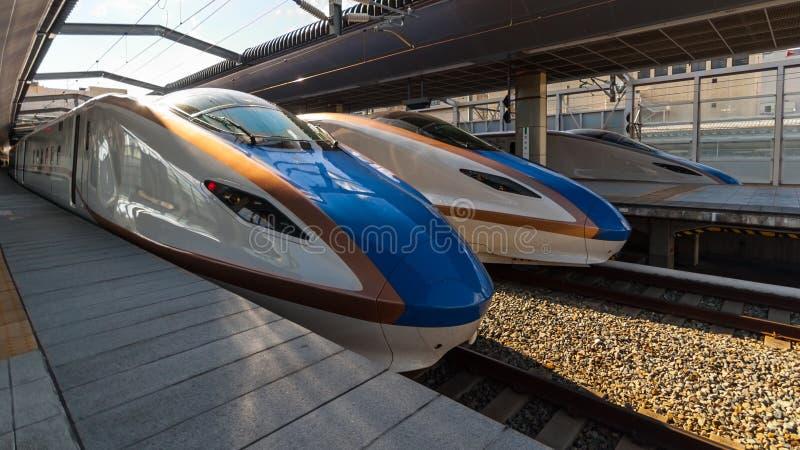 Three Series E7 Shinkansens. Tokyo, Japan - March 04, 2015: Three Series E7 Shinkansens sit side by side at Tokyo station stock images