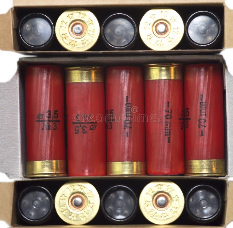 Three sets of Shotgun cartridge of 12 gauge, rifle ammo stock images