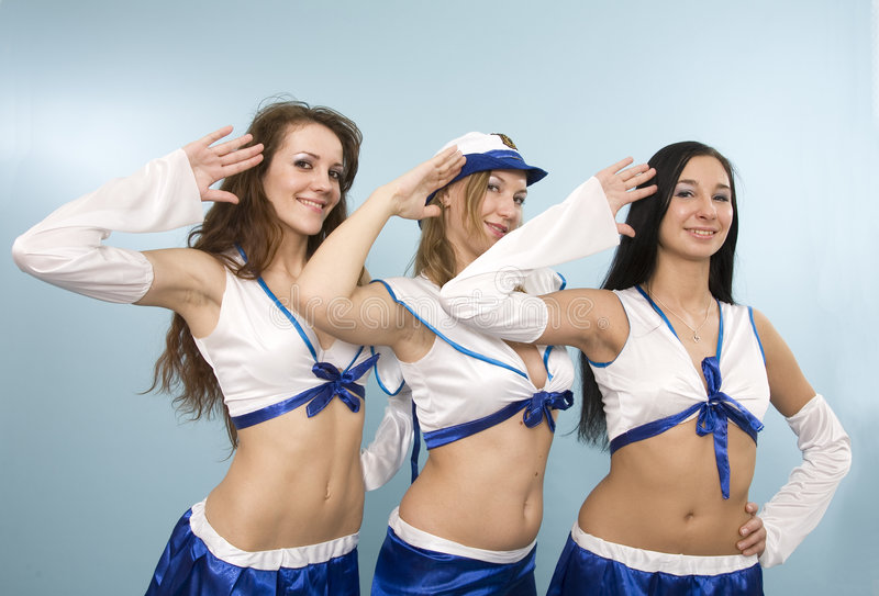 Three shipmates. A studio view of three women dressed as shipmates giving a high salute royalty free stock images