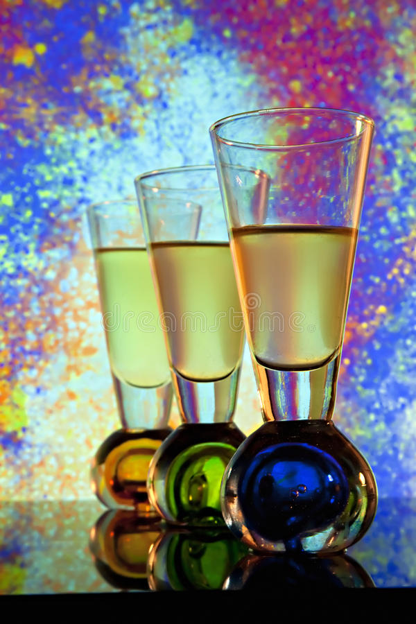 Three Shooter Glasses with colorful background stock image
