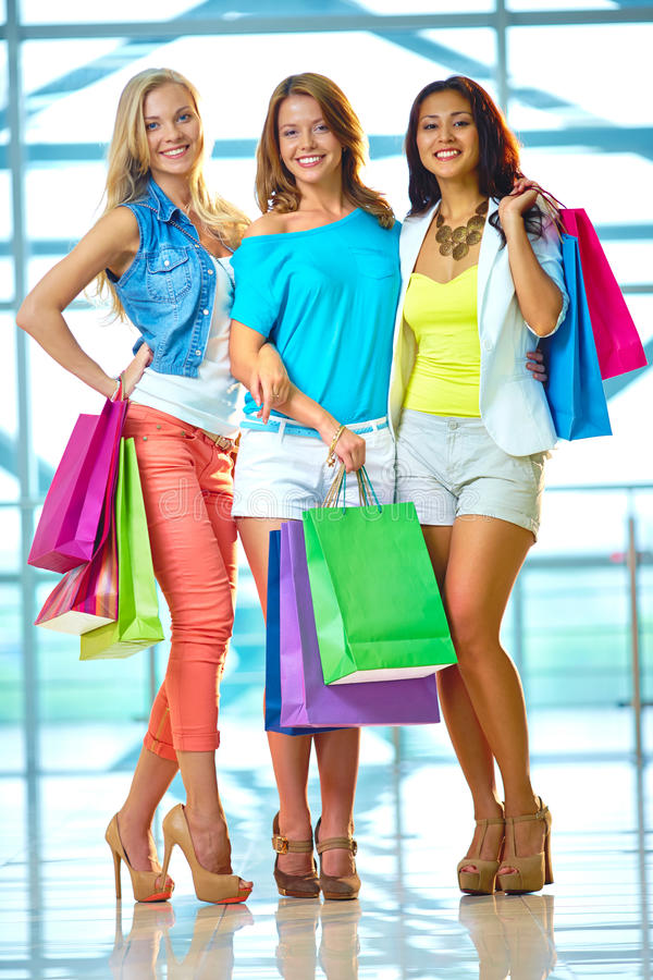 Three shoppers royalty free stock photos