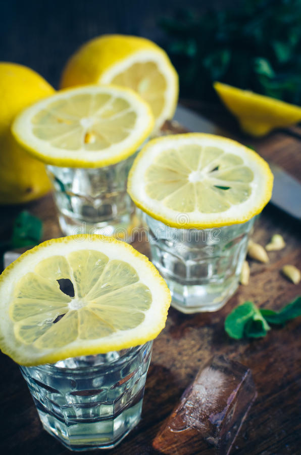 Three shots of vodka and lime slice. royalty free stock photo