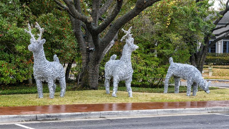 Three silver reindeer figures in a Christmas display in Dallas, Texas. Pictured are three silver reindeer figures making up a Christmas display in Dallas, Texas stock photos