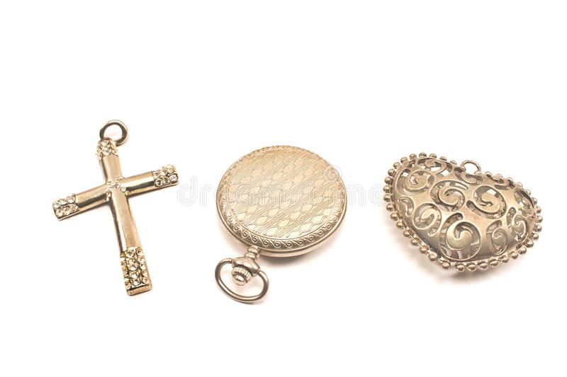 Three silver vintage objects - watch, cross, heart isolated on w. Hite royalty free stock photos