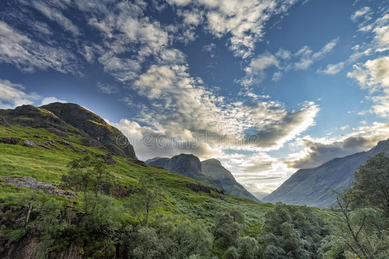 The three sisters. Afternoon view of The three sisters Beinn Fhada, Gearr Aonach, and Aonach Dubh near the Meeting of the Three Waters in Glencoe, Scotland royalty free stock photo