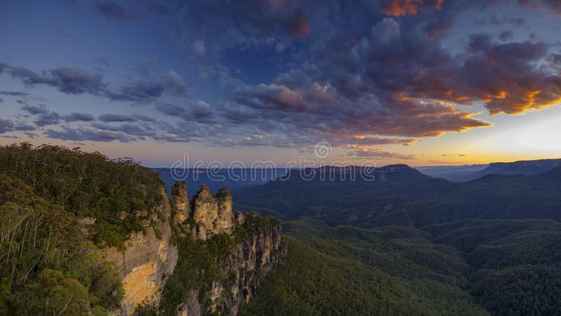The Three Sisters and the Blue Mountains at Sunset, Katoomba, NSW, Australia. Katoomba, Australia - November, 2018: The Three Sisters and the Blue Mountains at royalty free stock photography