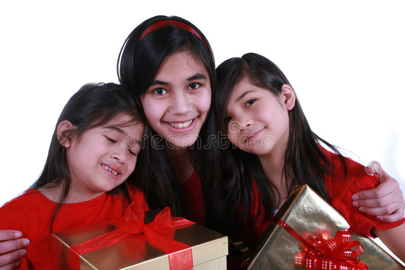 Three Sisters Holding Presents Stock Photo