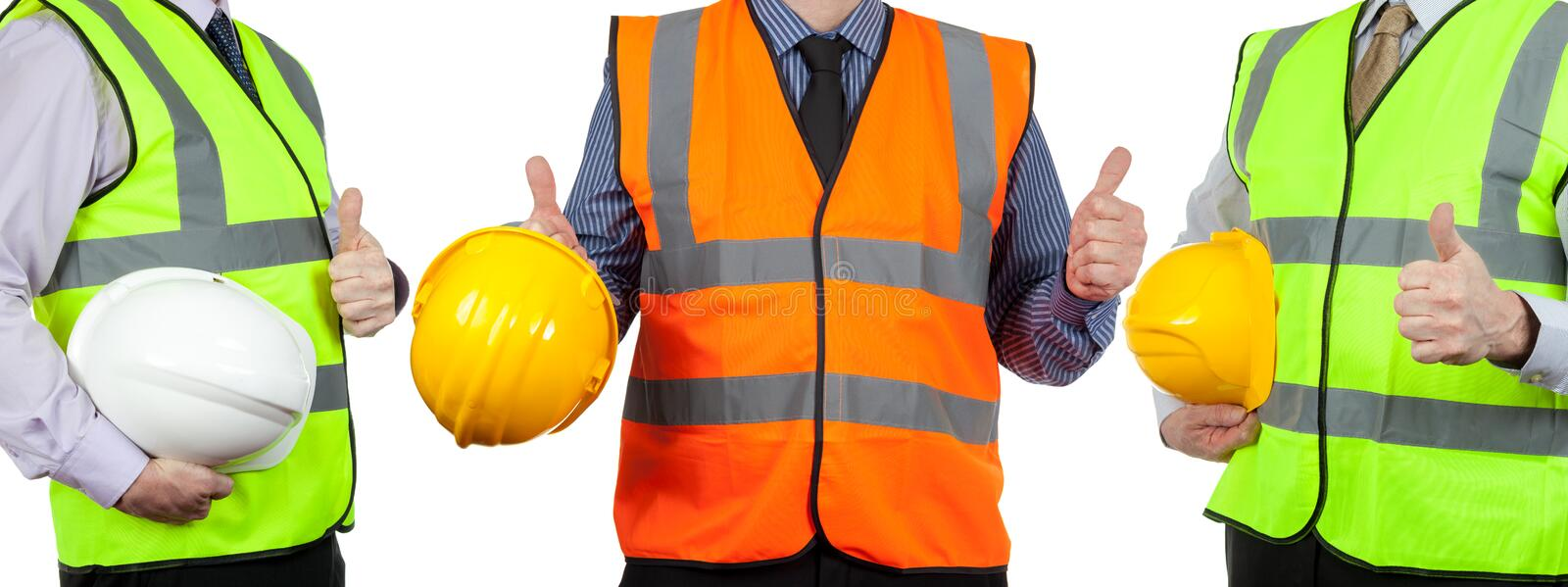 Three site surveyors in high visibility vests giving the thumbs up stock images