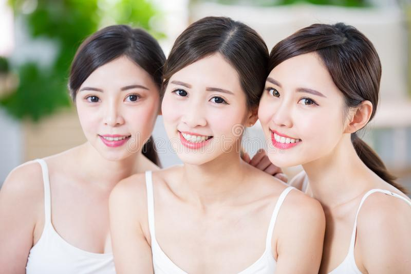 Skin care asian women friend. Three skin care asian women friend smile to you with charming teeth stock images