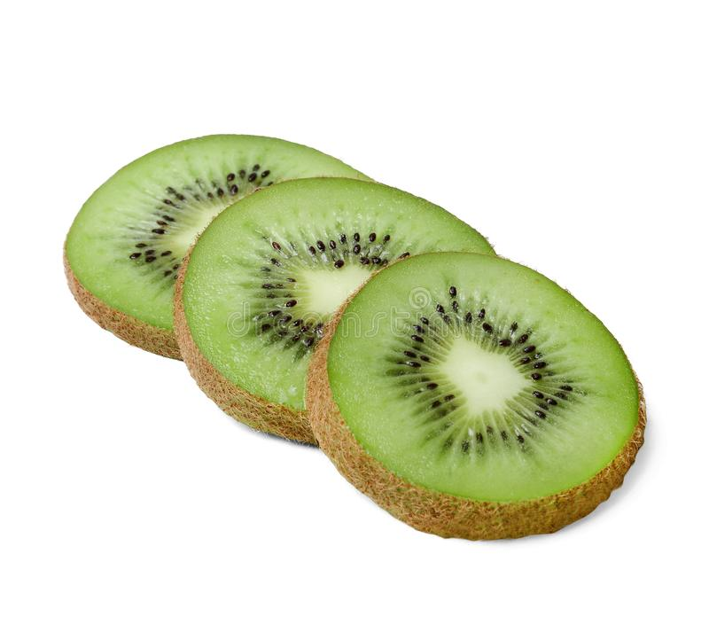 Three slices of juicy kiwi on a white isolated background. Top side view. Texture and shape. Three slices of juicy kiwi on a white isolated background. Close-up royalty free stock image