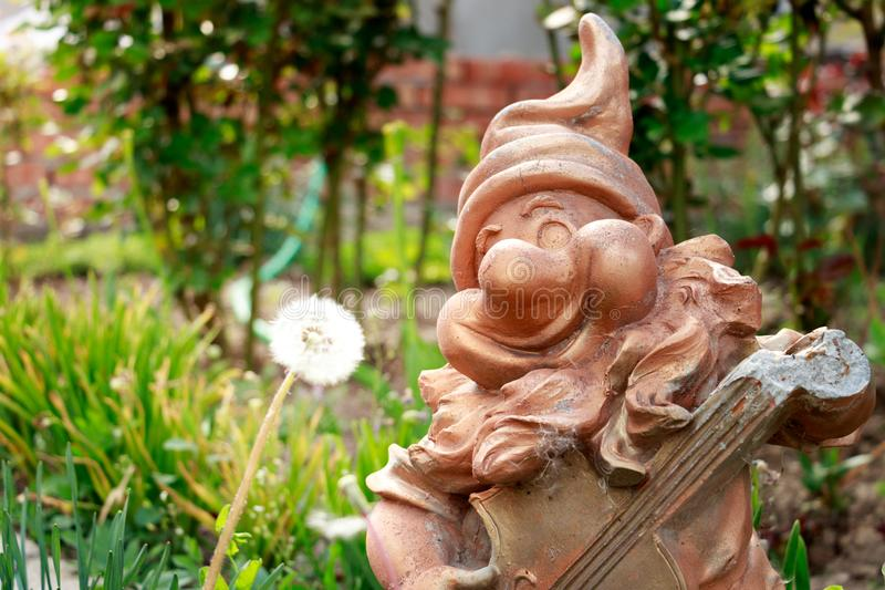 Garden dwarf made of gilded concrete royalty free stock photos