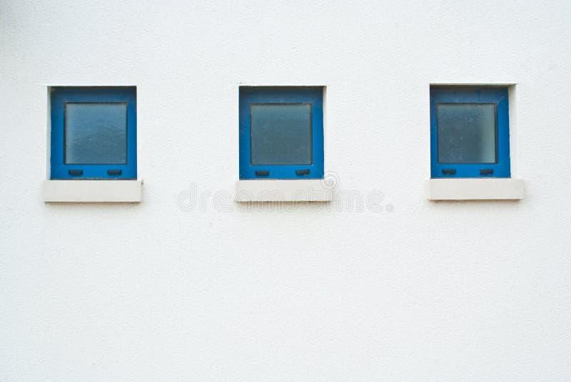 Three small blue windows stock photo