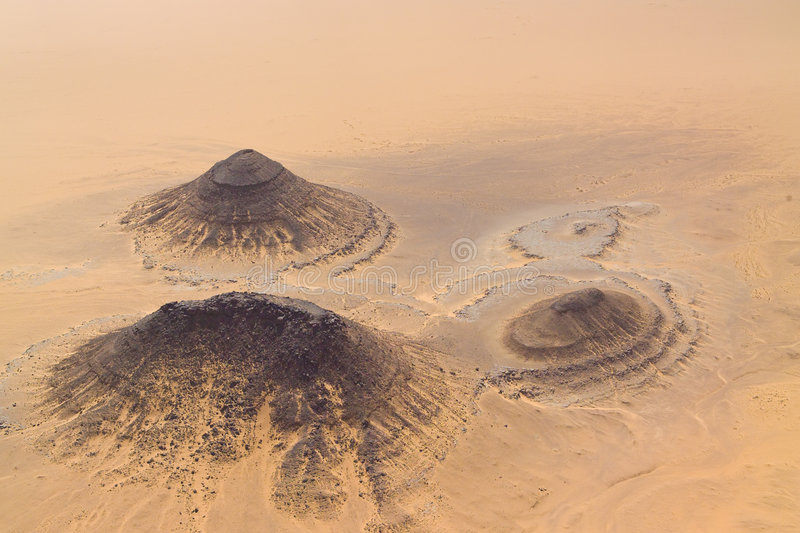 Three small isolated mountains in the desert in Ni royalty free stock photos