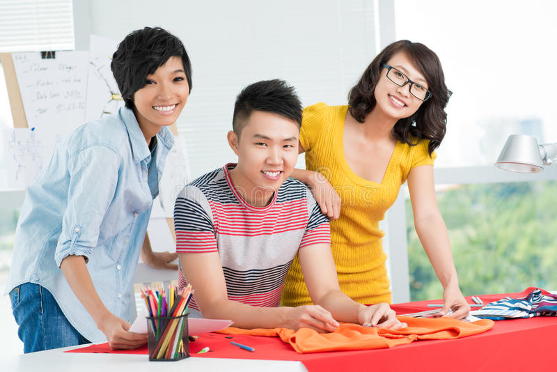Three smiling Asians royalty free stock photo