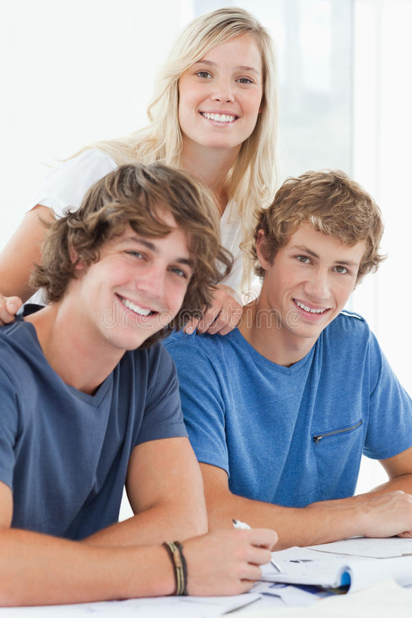 Download Three Smiling Students As They Look At The Camera Stock Image - Image: 25336219