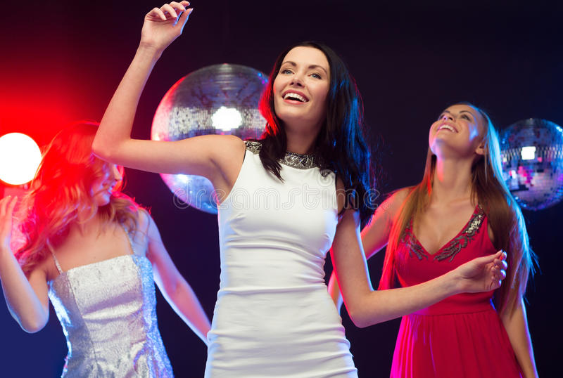 Three Smiling Women Dancing In The Club Royalty Free Stock Photography