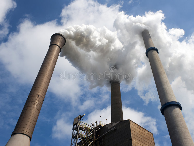 Three Smoke Stacks in perspective royalty free stock images