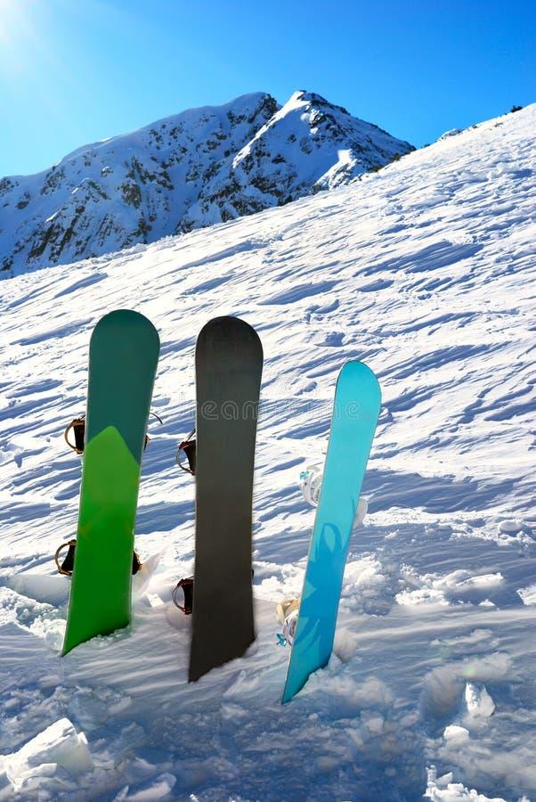 Download Three Snowboards Under Sun Stock Photo - Image: 8888480