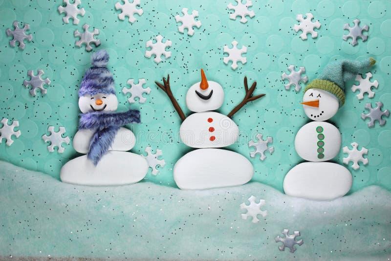 Three Snowmen Enjoying the Snow. Fun Winter Scene of Three Snowmen Enjoying the Snow Fall. Seasonal Scene royalty free illustration