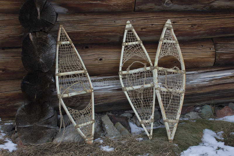 Three snowshoe at the wall of the wooden house royalty free stock photos