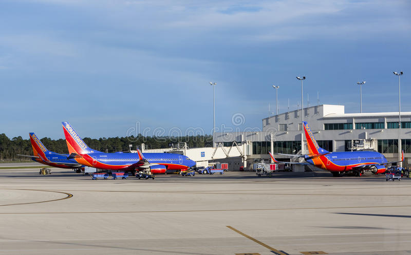 Three Southwest airplanes A320 parked at a Southwest Florida International Airport (R royalty free stock photos