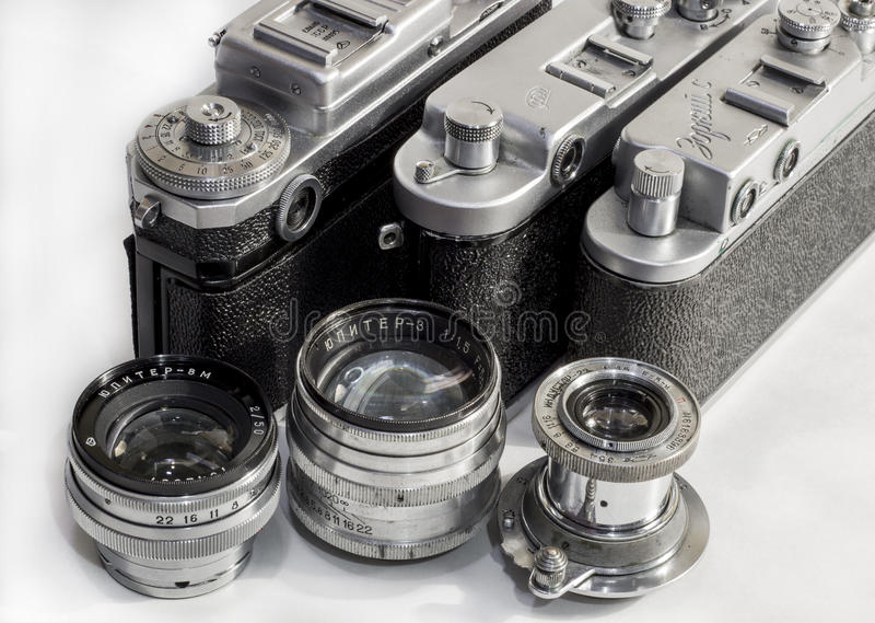 Three Soviet lens and camera. Soviet cameras Zorkiy S Fed-2 Kiev. Lens Industar 22 Jupiter 3 Jupiter 8M royalty free stock photo