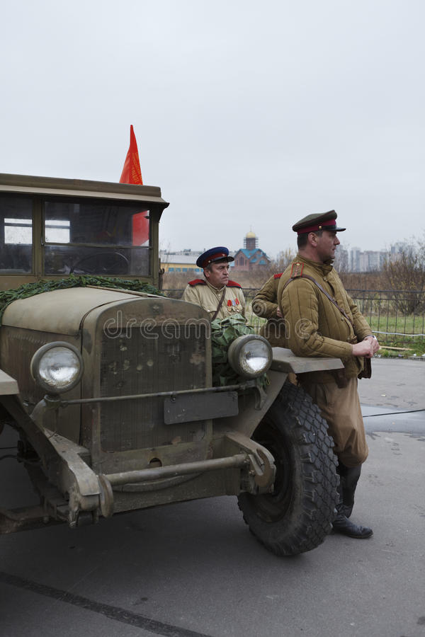 Three soviet soldiers standing near army lorry royalty free stock images