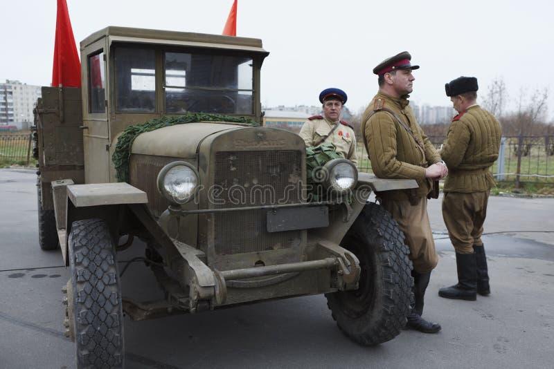 Three soviet soldiers standing near army lorry stock photos