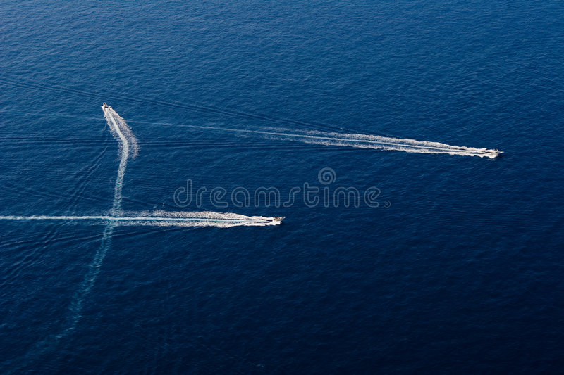 Three speedy motor boat in the stock photo