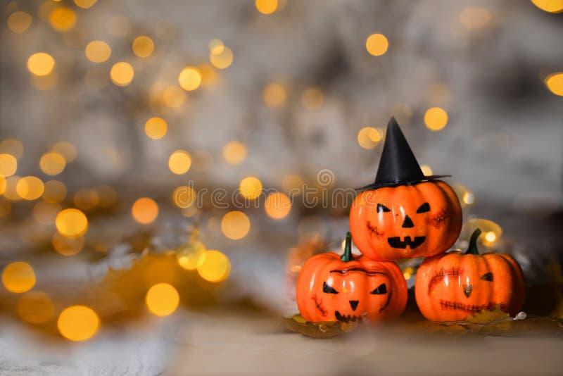 Three spooky orange pumpkins. Closeup royalty free stock photos