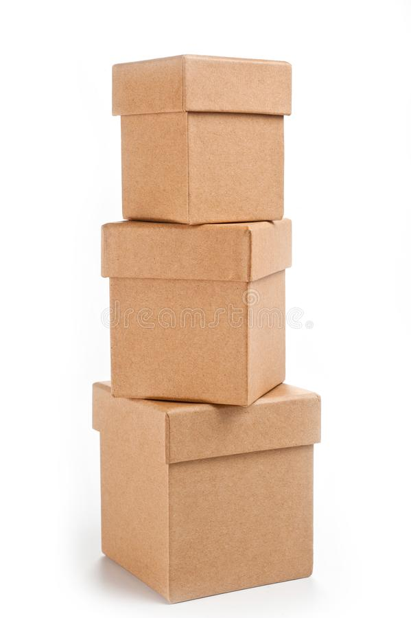 Three square boxes of eco-friendly cardboard on white background.  royalty free stock photography