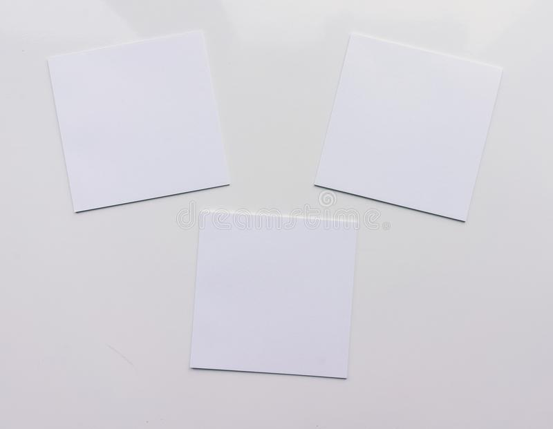Three square sheet on a white background. Top view. Close-up royalty free illustration