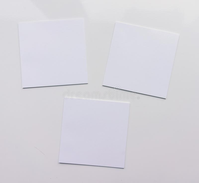 Three square sheet on a white background. Top view. Close-up stock illustration