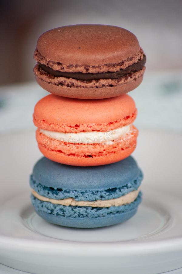 Three Stacked Macaron Cookies on White Plate stock image